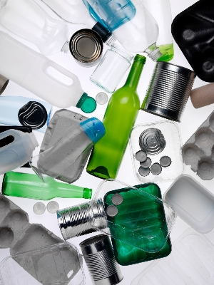 A photo of bottles, cans and other items for recycling