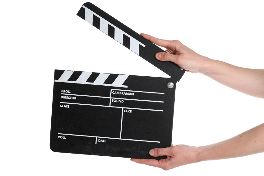 A photo of a film slate being used at a film shoot