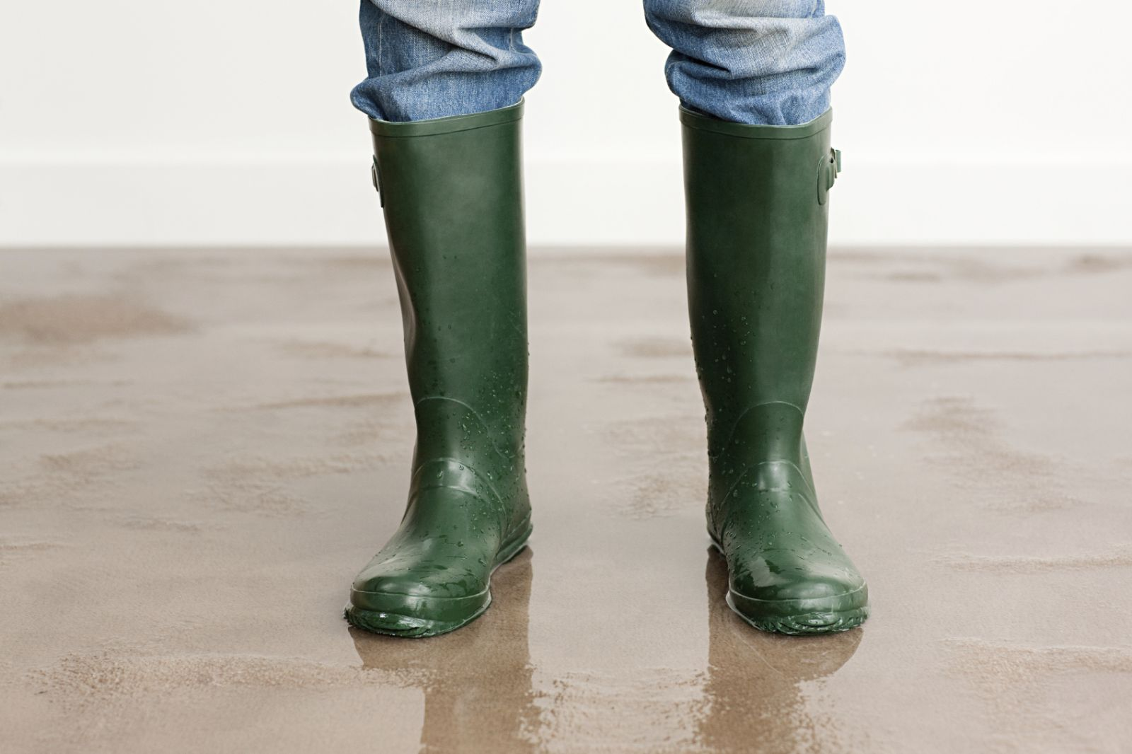 Green boots standing in water