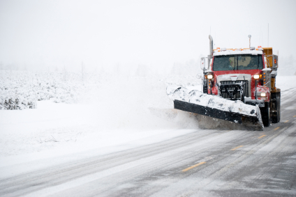 Photo of a snow plow on a winter road